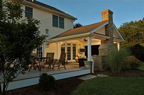 Backyard Covered Patio Designs by Covered Porch With Stone Hearth Fireplace And Attached