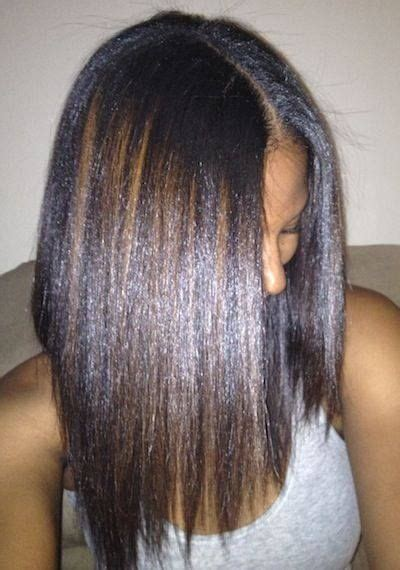 photo of relaxed hair that has been streaked grry so shiny and healthy looking black hair hair streaks