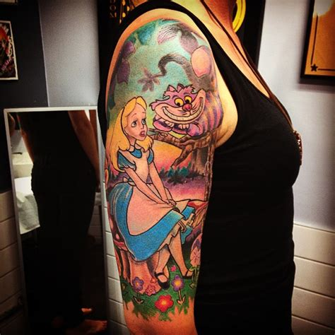 alice in wonderland tattoo sleeve in on right half sleeve