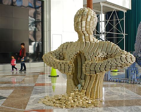 how to build a canned food sculpture quot canstruction quot food can sculpture exhibit and food drive