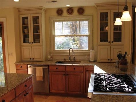 painted and stained kitchen cabinets like stained lower cabinets with painted upper kitchen