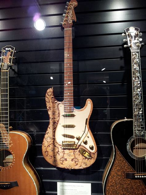 filefender carved floral stratocaster  taylor liberty tree guitar  museum