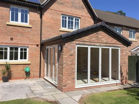 sun room extension with bi fold doors mcknight sons builders