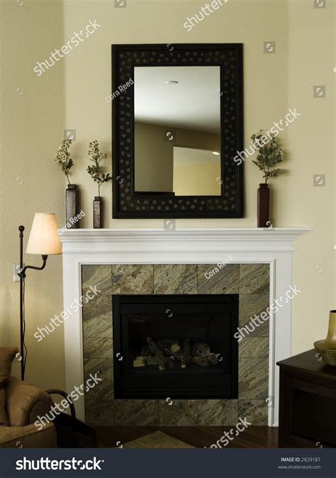 how to decorate empty space next to fireplace decor