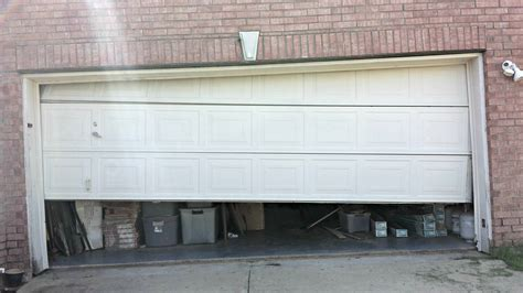 Open Garage Door With Broken by Garage Door Openers Cowtown Garage Door