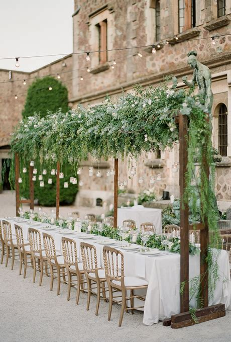 wedding reception arbor with hanging greenery wedding
