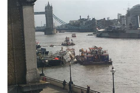 thames river cruise sinking rescue operation under way as boat sinks on river thames