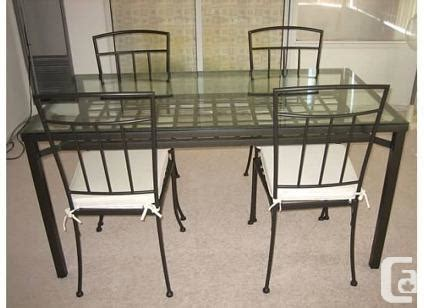 ikea metal frame glass top dining table plus 4 chairs