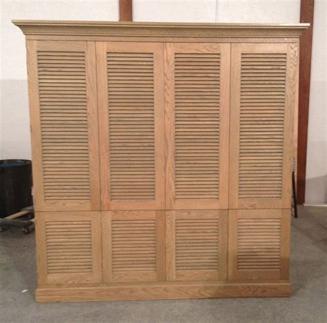 made entertaiment cabinet with louvered doors by j