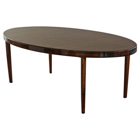 extension dining room table rosewood oval extension dining table by johannes andersen at 1stdibs