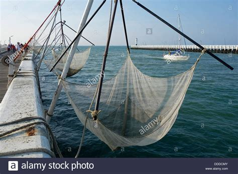 square fishing nets bag net for rent for tourists on the - Pier Fishing Net