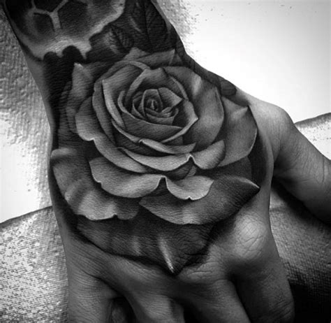 black and grey rose tattoo on hand 50 3d hand tattoo designs for men masculine ink ideas