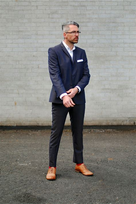 how to style a blue gold suit menswear modelled by the