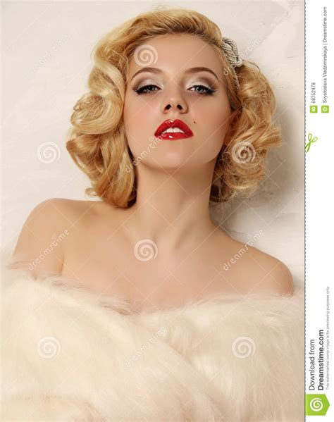 sexy woman blond hair stock photography image 10097442 woman with blond curly hair and bright makeup wears fur