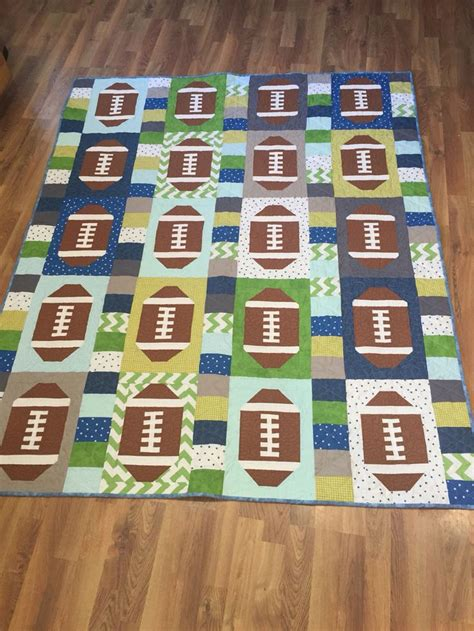 Seattle Quilt Company by 25 Best Ideas About Football Quilt On Quilt
