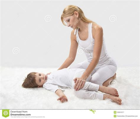 mom son bed mother and son do yoga royalty free stock photography