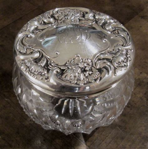 Vanity Jar by Sterling Silver And Cut Glass Floral Repousse Vanity