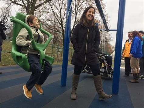 swing city pittsburgh accessible playground equipment being installed in city