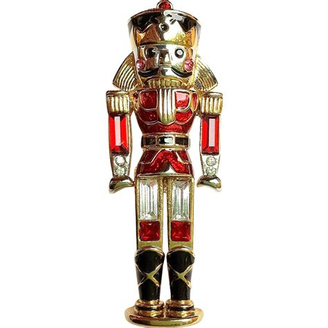 signed monet christmas nutcracker toy soldier pin brooch
