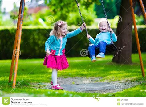 play boy swing videos kids on playground swing stock photo image 57179386