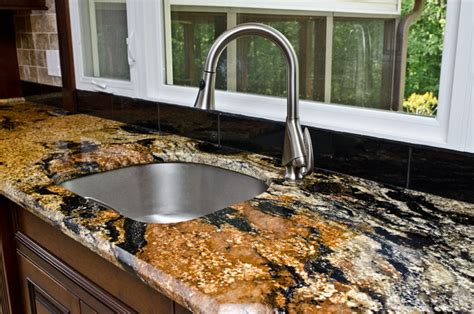 Pendant Kitchen Lights Over Kitchen Island magma gold granite kitchen in owings md traditional