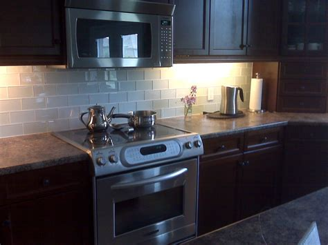 glass subway tile backsplash kitchen with