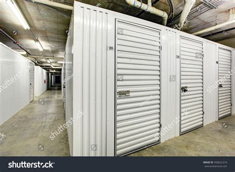 white storage units basement apartment building stock