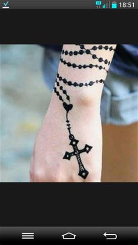 rosary henna tattoo cross rosary wrapped around arm tattoos