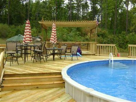 multi level wood deck   ground swimming pool