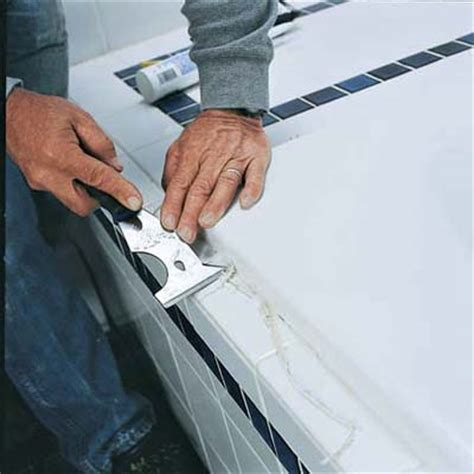 replacing bathroom caulk remove existing caulk how to caulk around a tub this
