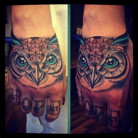 hand owl tattoo by time travelling tattoo