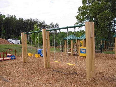 playground with swings playground swings benches chairs swings pinterest