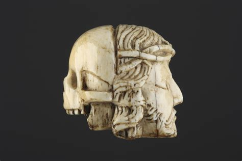 ivory skull carved ivory janus rosary bead depicting the