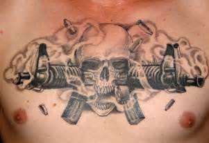 Bullets skull and gun tattoos on chest