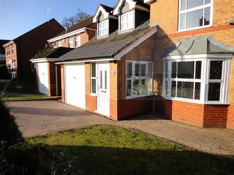 before and after photos porch garage extension with a