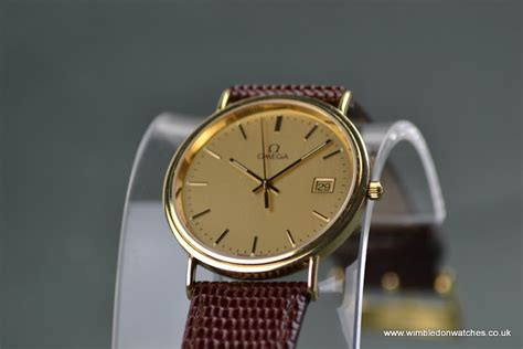 gents omega 18ct solid gold with original omega