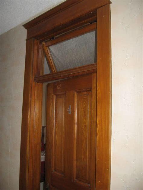 Second floor hallway, stairway, transoms, wood floors