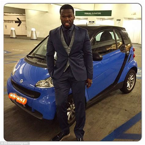 50 cent new car 50 cent looks jokes about bankruptcy by posing with smart