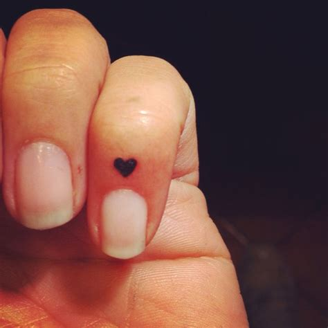 heart tattoo on finger best 25 finger tattoos ideas on small