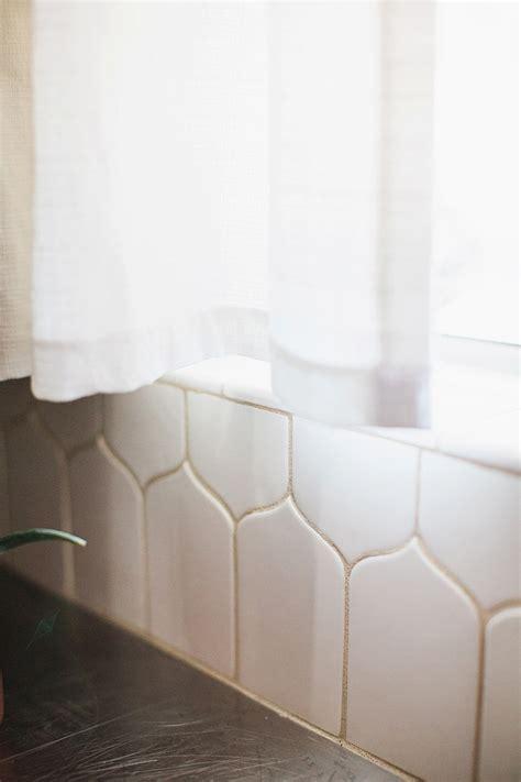 White kitchen backsplash remodel   Diana Elizabeth