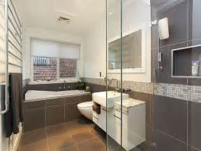 classic bathroom design with recessed bath using tiles float above the white cabinetry and marble flooring this