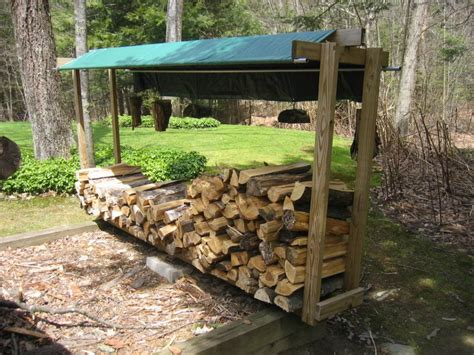 build a firewood rack the easy way build a simple diy outdoor firewood storage shed using reclaimed wood and blue tarpaulin cover ideas