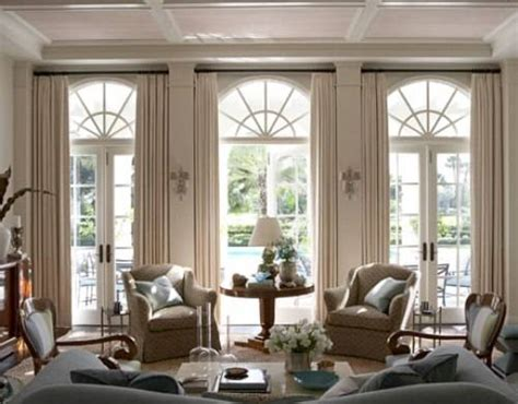 These attractive french doors are topped with palladian style windows