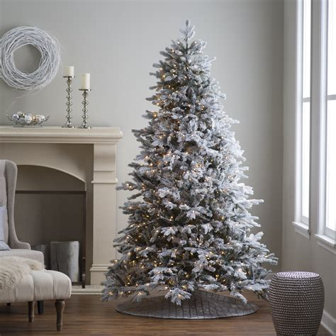 12 ft slim flocked christmas tree 7 5 ft pre lit cut flocked vermont spruce tree by sterling tree company