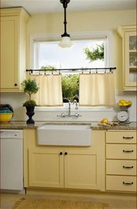 butter yellow kitchen cabinets 1000 ideas about yellow cabinets on cabinets