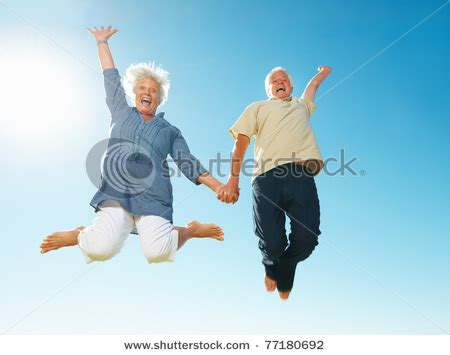 picture   elderly couple   people jumping  joy high   air   stock photo