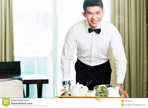 asian room waiter serving guests food in hotel stock image image 37934245