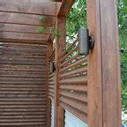 contemporary outdoor space  reclaimed timber pergola