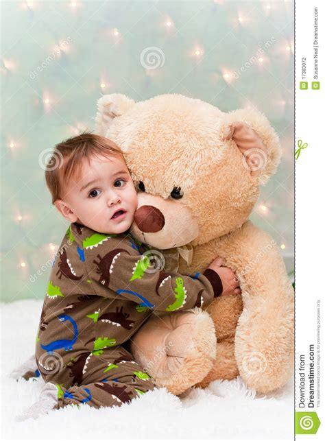 christmas baby  pajamas holding teddy bear stock photography image