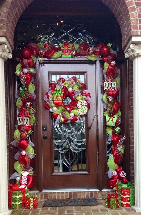 pin  lori newell  wreaths front door christmas